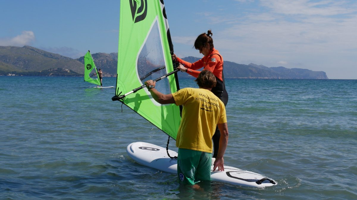 which is easier to learn kiteboarding or windsurfing?